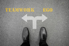 Decision to make - teamwork or ego Stock Photography