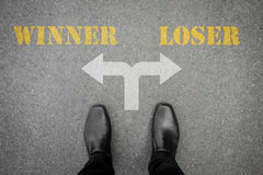 Decision to make - winner or loser Stock Photography
