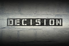 Decision WORD GR. Decision stencil print on the grunge white brick wall Stock Image