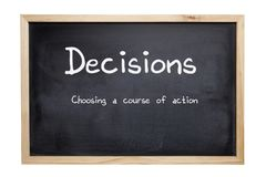 Decisions Concept Blackboard. Decisions Concept - a blackboard with the words descisions, choosing a course of action. Clipping path for board Royalty Free Stock Images