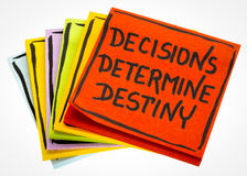 Decisions determine destiny reminder note. Decisions determine destiny reminder - handwriting in black ink on an isolated sticky note royalty free stock images