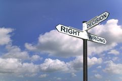 Decisions sign in the sky Stock Photography