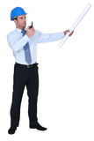 Decisive architect giving orders. Decisive architect giving out orders royalty free stock image