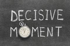 Decisive moment. Phrase handwritten on chalkboard with vintage precise stopwatch used instead of O royalty free stock photo