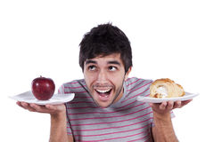 Decisão do alimento do homem novo Fotografia de Stock
