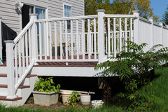 Deck. With white vinyl rails Stock Photos
