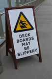Deck boards may be slippery sign Stock Photos