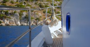 Deck of the boat. Sailing in the sea near islands stock video