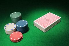 A deck of card and chips Stock Images