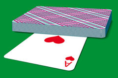 Deck of cards. On green surface stock illustration