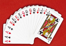 Deck of Cards. Cards bigger than 10 in a classic playing cards deck isolated on red background Royalty Free Stock Image