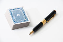 Deck of cards with black pen Royalty Free Stock Photography