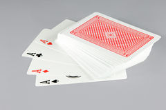 Deck of cards with four aces revealed. On gray background with clipping path Royalty Free Stock Photos