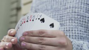 A deck of cards in the hands of an illusionist