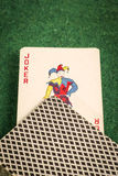 Deck of Cards with Joker. On Green Stock Images