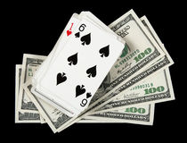 Deck of cards and money on black background Stock Photography