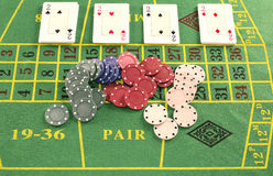 Deck of cards with pieces of poker. On green carpet Stock Photo