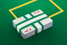 Deck of cards on poker table Royalty Free Stock Images
