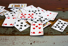Deck of cards on vintage table Royalty Free Stock Images