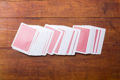 Deck of cards on wooden table Royalty Free Stock Photo