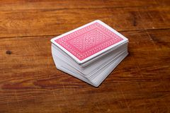 Deck of cards on wooden table Royalty Free Stock Photos