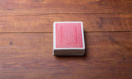Deck of cards on wooden table Stock Image
