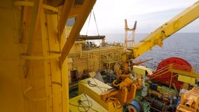 Deck cargo operations on offshore drilling rig stock footage