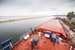 Deck of cargo ship moored in a harbor Royalty Free Stock Image