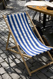 Deck Chair. On Cobbled Stones, Flea Market, Brussels, Belgium, Europe Royalty Free Stock Image