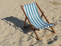 Deck chair. A classic blue and white stripped deck chair on Porthminster beach, in St Ives, Cornwall, England Stock Photos