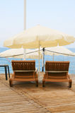 Deck-chair against the sea and sky. Royalty Free Stock Images