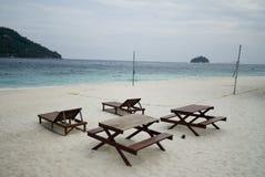 Deck chair by the beach Stock Photos