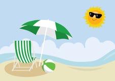 Deck chair, beach ball and umbrella on a beach Stock Photo