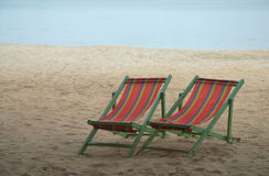 Deck chair on beach Stock Images
