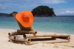 Deck chair on the beach with hat Royalty Free Stock Image
