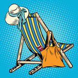Deck chair with beach things women Royalty Free Stock Photography