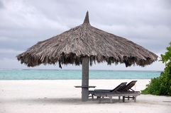 Deck chair and big umbrella at beach Royalty Free Stock Images
