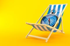 Deck chair with compass. Isolated on orange background Stock Images