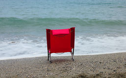 Deck chair facing the sea. A deck chair facing the sea Stock Photo