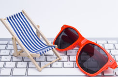 Deck Chair glases on keyboard Royalty Free Stock Images