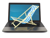 Deck chair with laptop. Isolated on white background Stock Photo