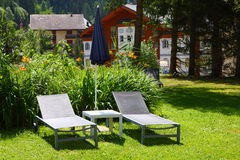 Deck chair in lawn Stock Photo