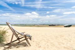 Arcachon Bay, France, deck chair on the beach. A deck chair left on a wild beach at low tide Royalty Free Stock Photos