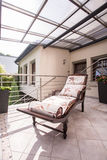Deck chair on luxury verandah Royalty Free Stock Photo