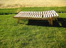 Deck chair made of wooden boards Royalty Free Stock Photos