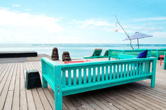 Deck chair and patio at ocean - Stock image Stock Photo