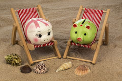 Deck chair with piggy bank Royalty Free Stock Photography