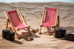 Deck chair on sandy beach Royalty Free Stock Photo