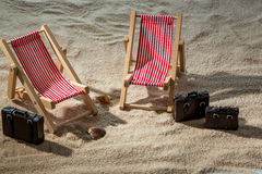 Deck chair on the sandy beach Royalty Free Stock Images