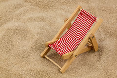 Deck chair on sandy beach Stock Photo